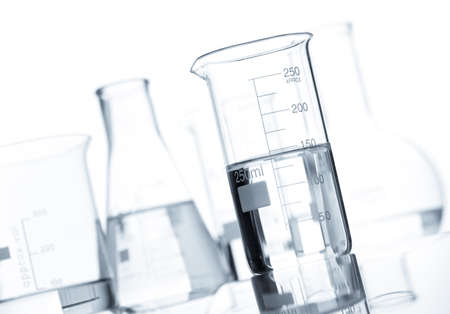 Group of classic laboratory flasks with a clear liquid, isolated