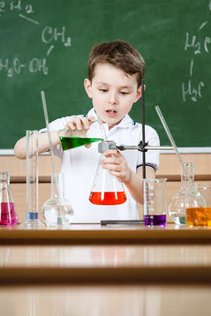 Little chemist holds scientific experiment
