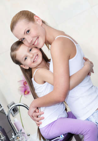 Mother and daughter hug each other in bathroom. Trust relationship