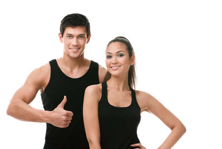 Two positive sportive people in black sportswear, isolated on white
