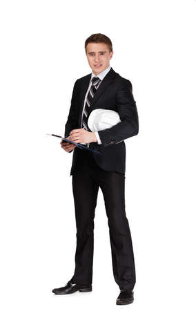 Full length portrait of businessman with white hard hat, isolated on whiteの写真素材