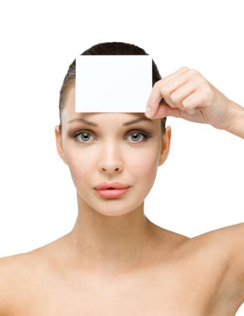 Nude girl hands white and blank copyspace card in front of her forehead, isolated on white