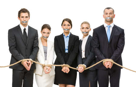 Group of business people tied with rope and their mouths are taped , isolated on white. Concept of routine work and slavery
