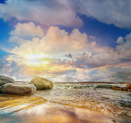 Photo pour Colorful panoramic landscape with stones and waves at the lake shore on sunset. Lithuania. Kauno marios. - image libre de droit