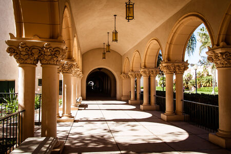 Close up view of ornate arches and walkway in Balboa Park, San Diego.