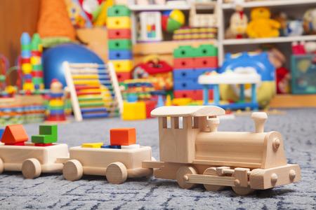 Foto de wooden train in the play room and many toys - Imagen libre de derechos
