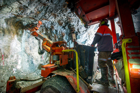 Gold mining underground inside a tunnel. russia