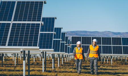 Photo pour Technicians at a solar power station - image libre de droit