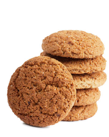 Closeup view of stack of oatmeal cookies over white background