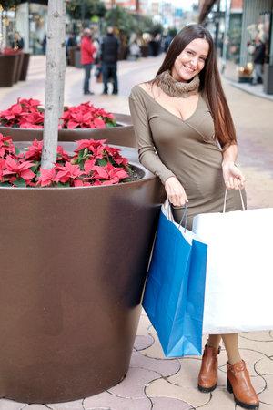 Foto de Girl with colorful paper bags, shopping at the mall. - Imagen libre de derechos
