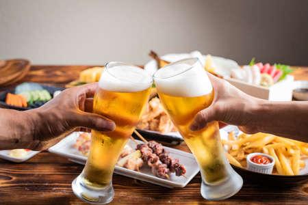Photo for toasting image with beer and japanese izakaya food - Royalty Free Image
