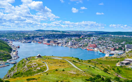 St John's Harbour in Newfoundland Canada.  Panoramic view of the city. Warm summer day in August from atop the Historically famous Signal Hill in St. John's.