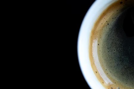 Foto de black coffee mug with foam and bubbles on black background - Imagen libre de derechos