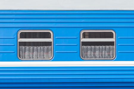 Symmetrical windows of the blue locomotive wagon