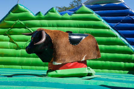 empty a mechanical bull in city amusement park