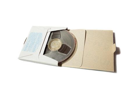Photo pour Retro reel to reel tape in a carton box on white background - image libre de droit