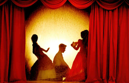 Photo pour A man and woman in theatrical costumes in the theater of shadows on the stage with red curtains. Love in the shadows theater. Red curtain of opera, cinema or theater stage drapes. - image libre de droit