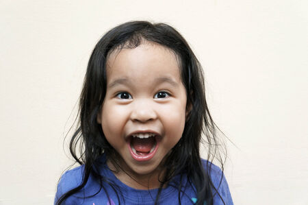 Little girl shouts with excitement