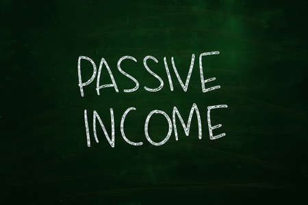 Passive Income Lettering, written with Chalk on Blackboard