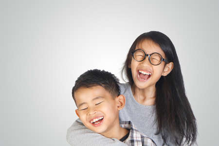 Photo for Portrait of young happy Asian brother and sister - Royalty Free Image