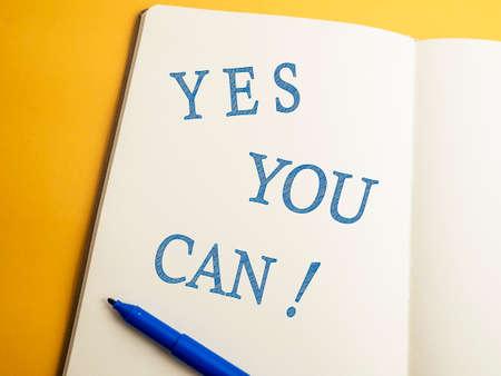 Foto de Yes You Can, business motivational inspirational quotes, words typography lettering concept - Imagen libre de derechos