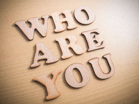 Foto für Who Are You in wooden words letter, motivational self development business typography quotes concept - Lizenzfreies Bild
