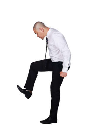 Foto de Young businessman wearing white suit and black pants stomping gesture. Isolated on white. Full body portrait - Imagen libre de derechos