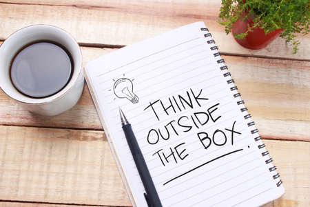 Foto de Think Outside The Box, business motivational inspirational quotes, words typography lettering concept - Imagen libre de derechos
