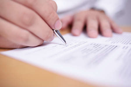 Photo pour Close up image of businessman signing contract or student having exam test, selective focus - image libre de droit