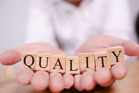 Foto de Quality, business ethics motivational inspirational quotes, words typography concept - Imagen libre de derechos