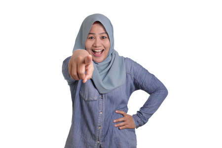 Foto de Portrait of Asian muslim lady wearing hijab pointing forward to camera as if choosing you gesture, business recruitment hiring concept - Imagen libre de derechos