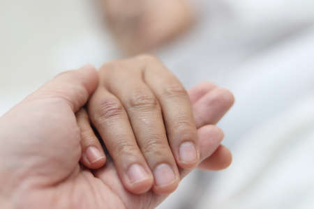 Photo for I'm here for you , doctor hand holding his patients to give love and support, selective focus with blurry background - Royalty Free Image