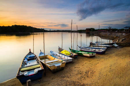 Sunrise Scenery at Lumut Bay,Perak,Malaysia with Resting Boat. Soft focus,Blur due to Long Exposure.