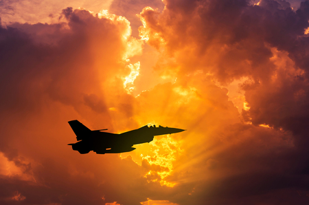 silhouette F - 16  falcon fighter jet military aircraft flying on sunset  background