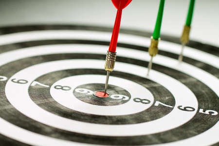 Photo for The red dart hits right on target. Winner. - Royalty Free Image
