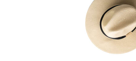 Photo pour Straw hat onwhite isolated background, beach holiday concept. Top view, selective focus - image libre de droit