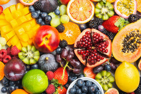 Photo for Delicious healthy fruit background mango papaya strawberries oranges passion fruits berries, top view, selective focus - Royalty Free Image
