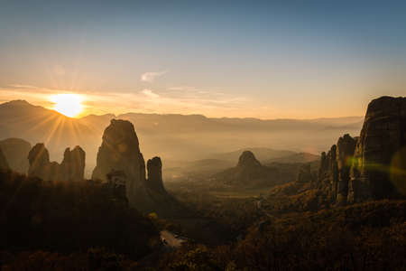 Beautiful lens flare from the sunset ower Meteora valley in Greece