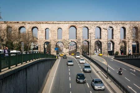 Istanbul, Turkey - March 22, 2015: Traffic under the Valens Aqueduct in Istanbul, Turkey