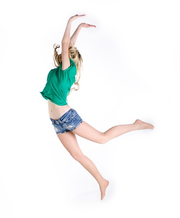 Girl jumping on white backgroundの写真素材