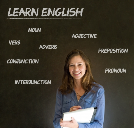Learn English confident beautiful woman teacher chalk blackboard background