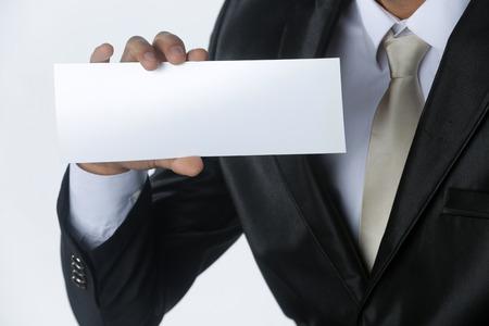 businessman holding card