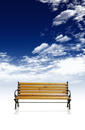 Deck chair with blue sky and clouds in the background
