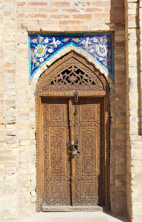 Finely carved wooden door at the Amir Temur Mausoleum, Samarkand, Uzbekistan. It is the mausoleum of the asian conqueror Tamerlane, aolso known as Timur. It is important in the history of Turkic-Persian Architecture as the precursor and model for later gr