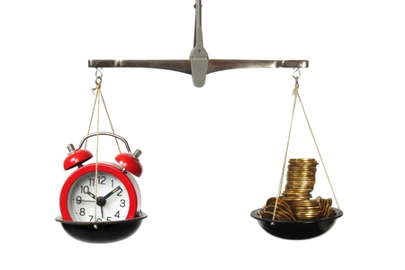 Photo pour Time is money concept with scales, clock and coins - image libre de droit