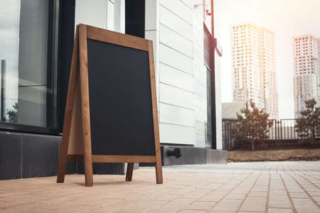 Photo for Sandwich Board at the street near skyscarpers. - Royalty Free Image