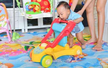 Photo pour Asian baby boy playing Baby Walker, Baby toy - image libre de droit