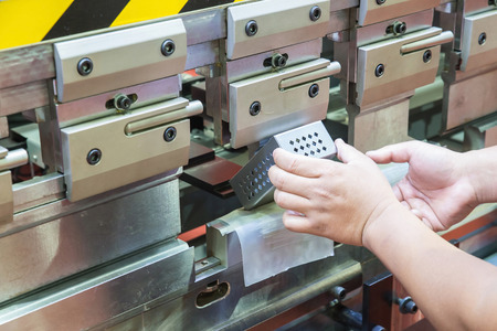 Worker at manufacture workshop operating cidan folding machine