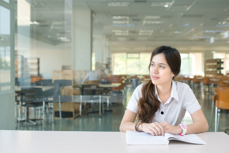 Asian student wondering or thinking about something
