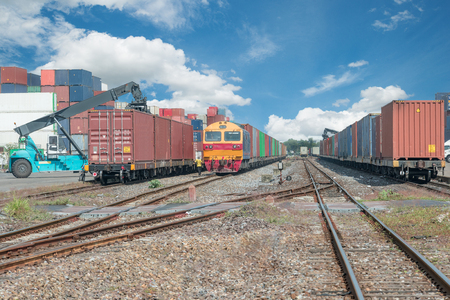 Photo for Cargo train platform with freight train container at depot - Royalty Free Image